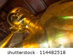 BANGKOK, THAILAND - AUGUST 03: the famous Reclining Buddha (Phra Buddhasaiyas) at Wat Pho temple, on August 3, 2012 in Bangkok, Thailand. the Buddha is 46 meters long and 15 meters high. - stock photo