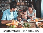 mom  dad and daughter are... | Shutterstock . vector #1144862429