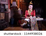 lao girl dressed in traditional ... | Shutterstock . vector #1144938026