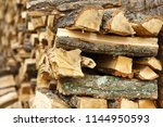 firewood pile stacked chopped... | Shutterstock . vector #1144950593