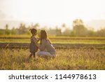 portrait of mom and daughter in ... | Shutterstock . vector #1144978613