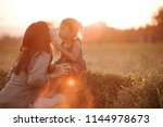 portrait of mom and daughter in ... | Shutterstock . vector #1144978673