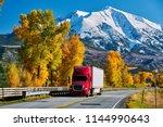 red truck on highway in... | Shutterstock . vector #1144990643