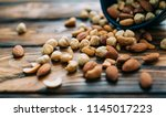 wooden bowl with mixed nuts... | Shutterstock . vector #1145017223
