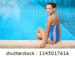 young beautiful woman in bikini ... | Shutterstock . vector #1145017616