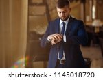 groom at wedding tuxedo smiling ... | Shutterstock . vector #1145018720