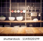 wood table top on blur kitchen... | Shutterstock . vector #1145020199