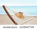 comfortable hammock with straw... | Shutterstock . vector #1145037749