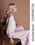 sexy luxurious woman in a dress ... | Shutterstock . vector #1145046716