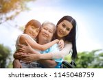 asian grandmother  mother and... | Shutterstock . vector #1145048759