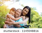 asian grandmother  mother and... | Shutterstock . vector #1145048816
