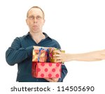 A person takes a gift from a business person - stock photo