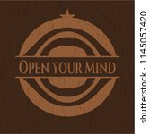 open your mind wooden emblem....   Shutterstock .eps vector #1145057420