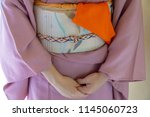 woman wearing a traditional... | Shutterstock . vector #1145060723