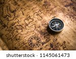 old black compass on ancient... | Shutterstock . vector #1145061473