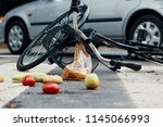 low angle on groceries and bike ... | Shutterstock . vector #1145066993