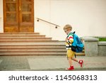 happy smiling kid in glasses is ... | Shutterstock . vector #1145068313