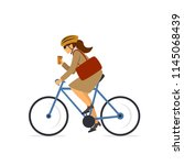 woman riding bike with  coffee... | Shutterstock .eps vector #1145068439