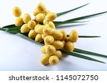 delicious raw sweet date fruits ... | Shutterstock . vector #1145072750