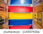 colorful awning on the street... | Shutterstock . vector #1145079206