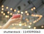 empty hands praying... | Shutterstock . vector #1145090063