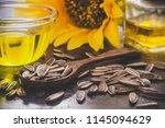 sunflower oil in bottle glass... | Shutterstock . vector #1145094629