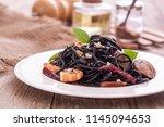 black spaghetti with shrimps... | Shutterstock . vector #1145094653