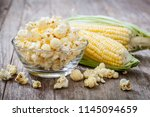 popcorn in bowl with sweet corn | Shutterstock . vector #1145094659