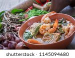 sour soup with prawn and... | Shutterstock . vector #1145094680