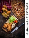 crispy fried chicken on a wood... | Shutterstock . vector #1145094683