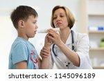 little school boy blowing to... | Shutterstock . vector #1145096189