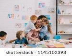 interracial kids hugging happy... | Shutterstock . vector #1145102393