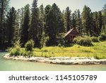 Stock photo forest and small house in it in summer day wooden two storey cottage cabin in the woods the 1145105789