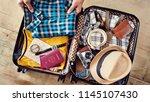 preparing travel suitcase high... | Shutterstock . vector #1145107430