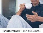 young asian freelance man ... | Shutterstock . vector #1145110826