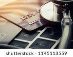 stethoscope on mock up credit... | Shutterstock . vector #1145113559