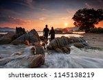 lovely couple holding their... | Shutterstock . vector #1145138219