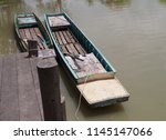 The two rowboats in the river...