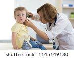 pediatrician examining child's...   Shutterstock . vector #1145149130