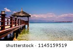 scenic seascape and wooden pier ... | Shutterstock . vector #1145159519