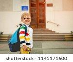back to school. pupil of... | Shutterstock . vector #1145171600