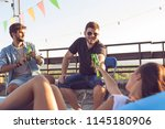 group of young friends having... | Shutterstock . vector #1145180906