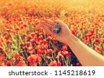 female hand with compass on... | Shutterstock . vector #1145218619