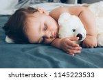 beautiful baby sleeping with... | Shutterstock . vector #1145223533