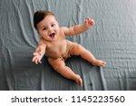 top view of smiling baby... | Shutterstock . vector #1145223560