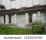 uninhabited house. door and...   Shutterstock . vector #1145223740