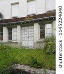 uninhabited house. door and...   Shutterstock . vector #1145224040