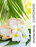 fresh coconut cuts with... | Shutterstock . vector #1145224103