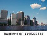tall modern constructed... | Shutterstock . vector #1145233553