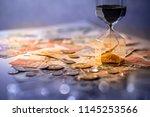 sand running through the shape... | Shutterstock . vector #1145253566